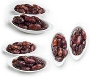 La cuvette de dates d'isolement sur le fond blanc, ensemble de fruit de dates a tiré dans différents angles photographie stock