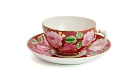 la cuvette a isolé le thé de soucoupe Photos stock