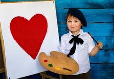 La déclaration de l'amour d'un jeune artiste dans un béret Image libre de droits