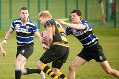La défense intense de rugby Photos stock