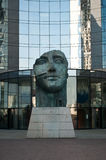 La défense - Tindaro statue by Igor Mitoraj with Buildings. PARIS - France - 23 March 2015 - La défense - Tindaro statue by Igor Mitoraj with Buildings Stock Photo