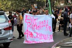 La démonstration d'étudiant de Makassar a critiqué les quatre années de photographie stock