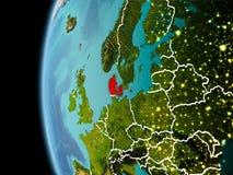 La Danimarca da spazio nella sera Fotografia Stock
