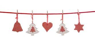La decoración aislada de la Navidad en blanco rojo comprobó hangi de los colores Foto de archivo