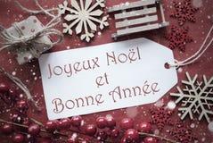 La decoración nostálgica de la Navidad, etiqueta con Bonne Annee significa Año Nuevo Imágenes de archivo libres de regalías