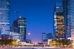 La Defence, Paris, France. Full moon over the stunning La Defence Parisian business district bristling with skyscrapers that started life in the 1960's. Arc de Stock Photos