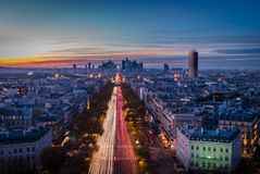 Nanterre at sunset seen from Arc de triomphe. La defense Arch and business district in Paris seen from the Arc de triomphe at sunset Stock Photo