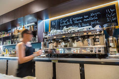 La defense, France - July 17, 2016: blurry barmaid in big traditional french restaurant in la defense city, the greatest business. Center in france near Paris stock images