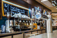 La defense, France - July 17, 2016: Draught beer taps in a big traditional french restaurant in la defense city, the greatest busi Stock Images