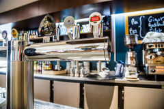 La defense, France - July 17, 2016: Draught beer taps in a big traditional french restaurant in la defense city, the greatest busi Royalty Free Stock Photography