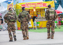 La defense, France - July 17 2016: French military patrol assigned to the surveillance of a business district near Paris. These tr Royalty Free Stock Image