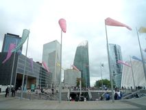 La Defense; Paris; France; August 18 2018: group of colored windsocks and some modern buildings on the background. La Defense; Paris; France; August 18 2018 royalty free stock photography