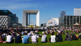 Lunch break, La Defense, Paris, France. A crowd of people sitting in the open at lunch hour enjoying the sun. La Défense, Paris, France Stock Photo