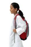 La demostración de la muchacha de la escuela trae el bolso Foto de archivo
