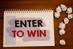 La demostración de la nota de la escritura entra para ganar Las fotos del negocio que muestran el premio recompensan el premio da Imagenes de archivo