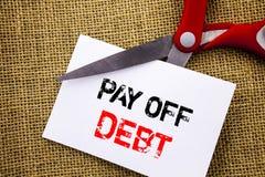 La demostración del texto de la escritura paga apagado deuda Recordatorio conceptual de la foto a pagar las cuentas debidas del p fotografía de archivo libre de regalías