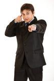 La demostración joven del hombre de negocios me entra en contacto con gesto Fotos de archivo libres de regalías