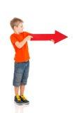 La derecha de la flecha del muchacho Fotos de archivo libres de regalías
