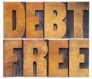 La deuda libera en el tipo de madera fotografía de archivo
