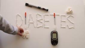 La DIABETES de la palabra es de la lanceta, de jeringuilla de la insulina, de glucometer y de una pluma de la jeringuilla metrajes