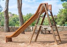 La diapositiva de los niños de madera Fotografía de archivo libre de regalías