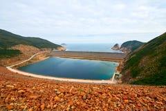 La diga orientale dell'alto bacino idrico dell'isola di Hong Kong Fotografia Stock Libera da Diritti