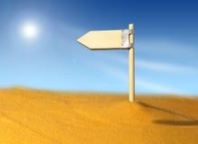 La dirección señal adentro el yermo. Imagenes de archivo