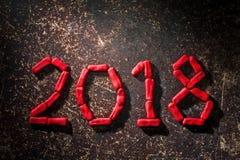 La disposición de las figuras por el Año Nuevo próximo 03 Imagen de archivo libre de regalías
