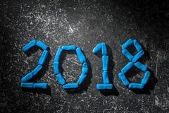 La disposición de las figuras por el Año Nuevo próximo 03 Imagenes de archivo