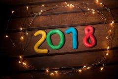 La disposición de las figuras por el Año Nuevo próximo Imágenes de archivo libres de regalías