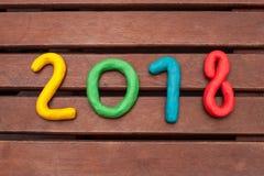 La disposición de las figuras por el Año Nuevo próximo Imagen de archivo libre de regalías