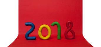 La disposición de las figuras por el Año Nuevo próximo 01 Fotos de archivo