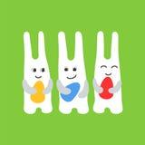 La diversión tres del conejito de pascua con los huevos de Pascua y las sonrisas se ponen verde libre illustration