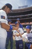 LA Dodger Catcher Mike Piazza. Signs autographs and balls for young fans, Dodger Stadium, Los Angeles, CA Stock Image