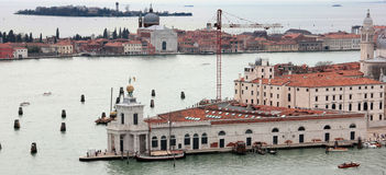 La Dogana di Mare. The Dogana di Mare is an area of ??Venice, is located on a narrow, triangular point of division between the Grand Canal and the Giudecca Canal Stock Photo