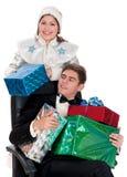 La doncella de la nieve da los presentes para la Navidad Imagen de archivo libre de regalías
