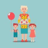 La donna anziana pronta agglutina per i suoi nipoti Fotografia Stock