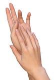 La donna applica la cura di pelle sulle mani Fotografia Stock