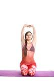 La donna atletica di forma fisica con lo sport helthy dello spazio in bianco del bordo del segno ha isolato le pose bianche di yo Immagine Stock Libera da Diritti