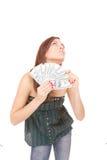 La donna attraente cattura un lotto di 100 fatture del dollaro Immagini Stock Libere da Diritti