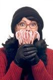 La donna attraente tiene le canne di caramella Fotografia Stock