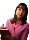 La donna cattura le note ed osserva Fotografia Stock