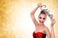 La donna celebra i nuovi anni o la festa di Natale Fotografie Stock