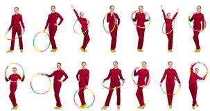 La donna che fa gli esercizi con il hula-hoop Fotografia Stock Libera da Diritti