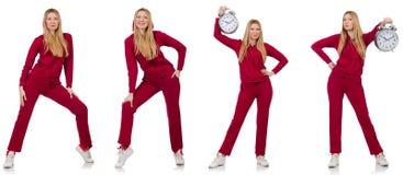 La donna che fa gli esercizi isolati sul bianco Immagine Stock