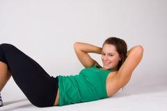 La donna che fare si siede aumenta   Fotografia Stock