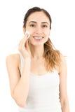 La donna che la pulisce compone con una palla di cotone Fotografia Stock