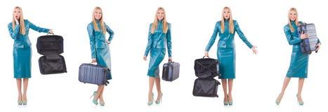 La donna che prepara per la vacanza con la valigia su bianco Fotografia Stock Libera da Diritti