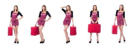 La donna che prepara per la vacanza con la valigia su bianco Fotografie Stock