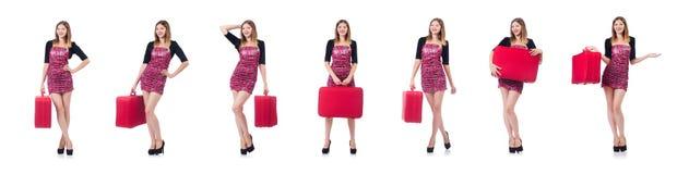 La donna che prepara per la vacanza con la valigia su bianco Immagine Stock